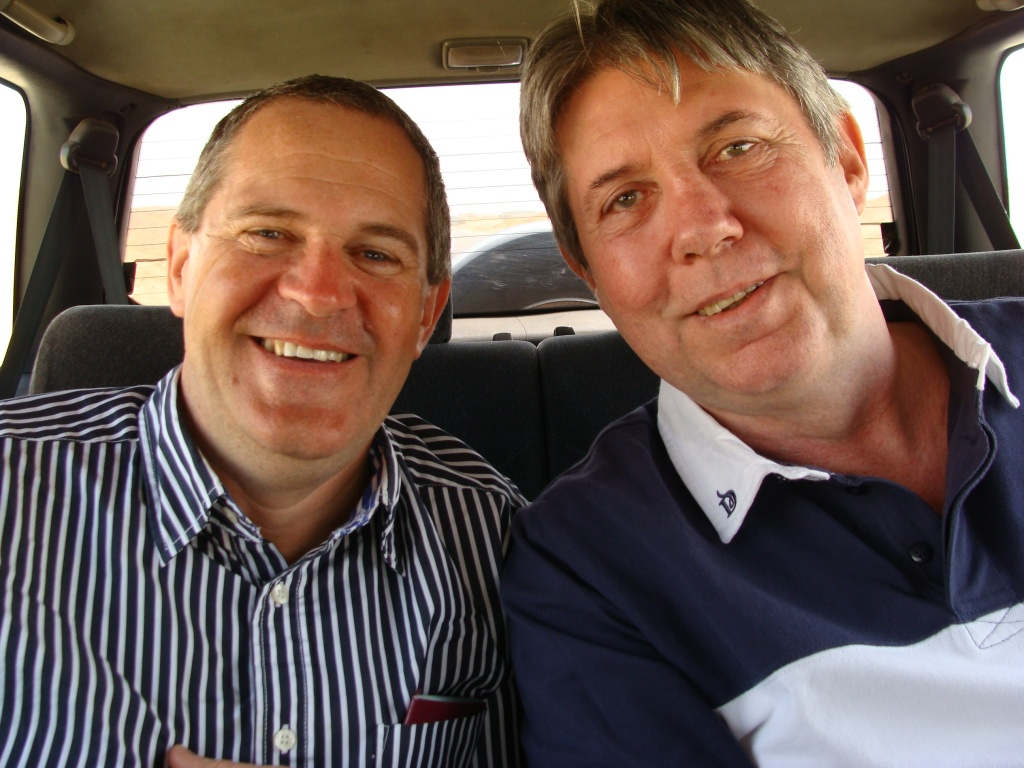 Norman with Eddie, racing through the desert in our 4x4 on the way to the press conference