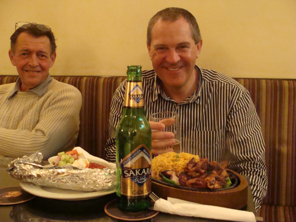 Norman savours the Fajitas at the BCA whilst airline catering manager, David Browett looks on