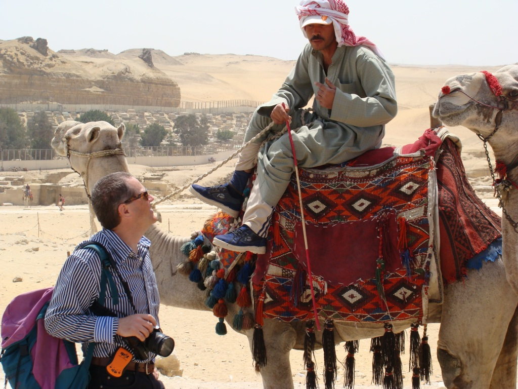Norman enjoys the banter with the camel drivers.