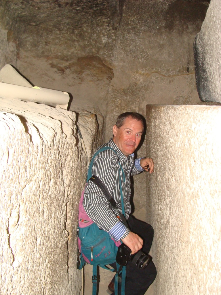 Norman finds it a tight fit behind the sarcophagus that is cut out of the solid bedrock!