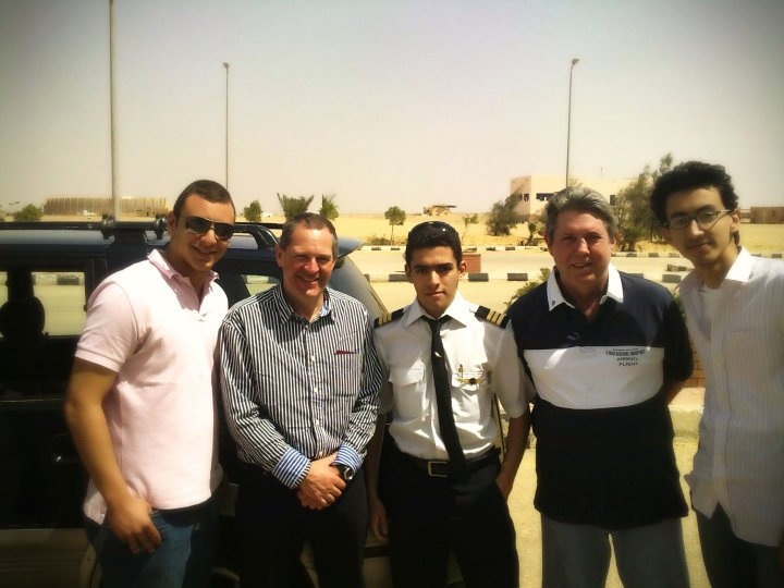 Group shot of Norman with Eddie and Ahmed and members of the Egyptian Aviation Academy outside the October terminal.