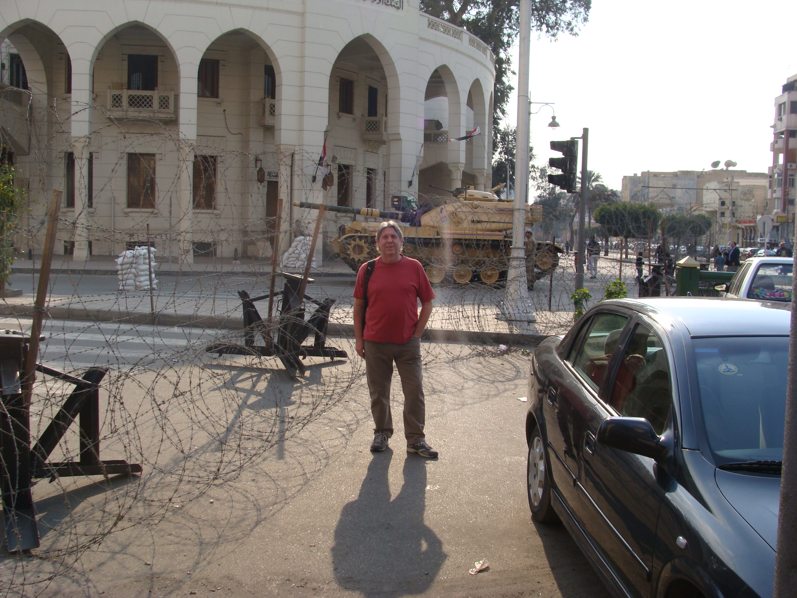 Eddie outside the Presidential Palace the day after Mubarak fled. Note the tank!