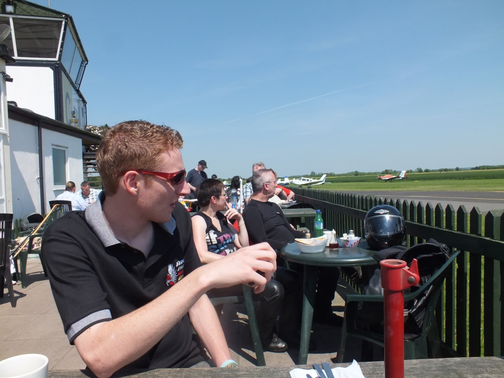 Dan enjoying the sun and aircraft with the control tower in the background