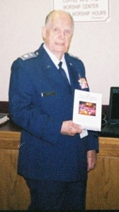 CAP Chaplain George Kelly displays a CAP Chaplain Service brochure. Photo - George Kelly