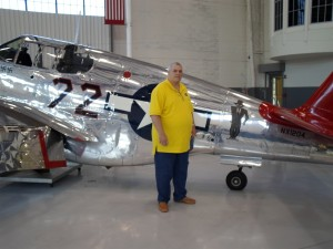 USAF and Vietnam veteran William Commerford poses beside the P-51C.Photo: John Stemple